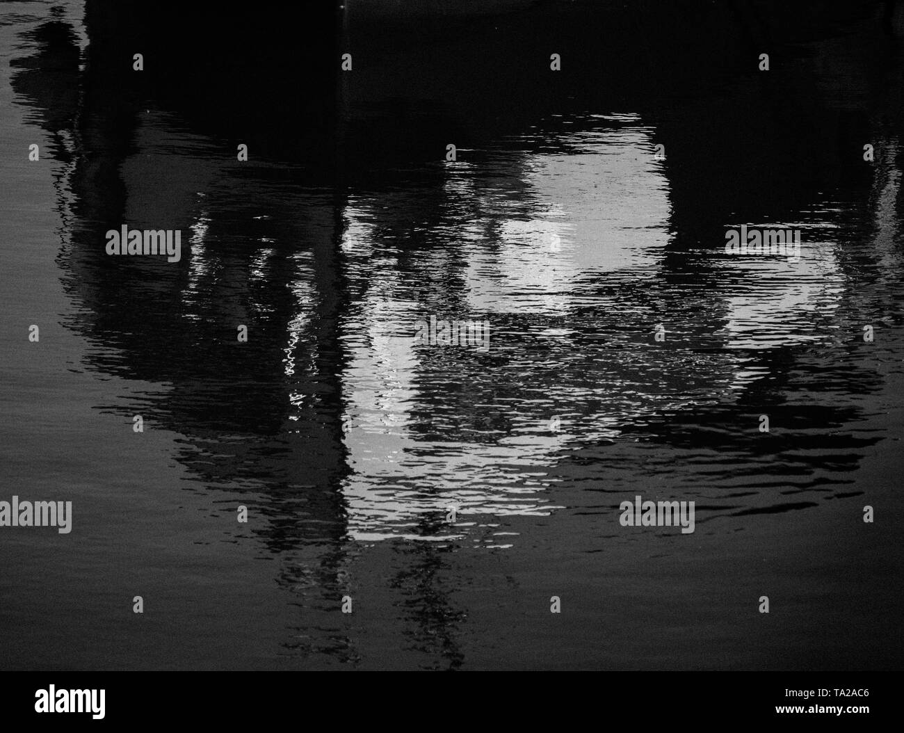 Black and White Photograph, Detail of Boat Reflected in Water of The River Thames, Henley-on-Thames, Oxfordshire, England, UK, GB. - Stock Image
