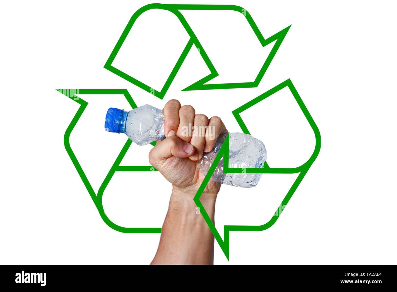 Hand squeezing Plastic Bottle representing movement against pollution and for recycling. Recycling logo in the background. - Stock Image