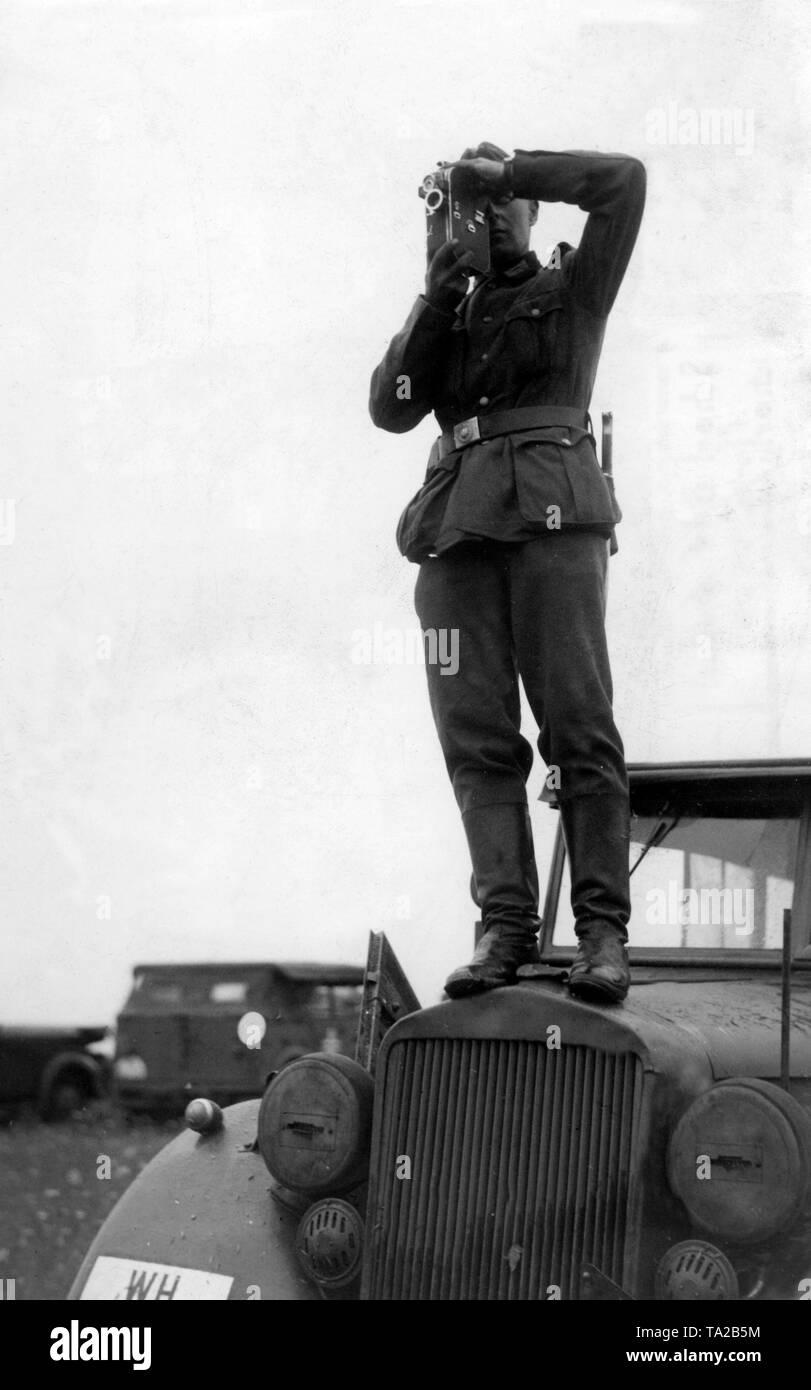 A PK (Propaganda Company) man films in France. Stock Photo