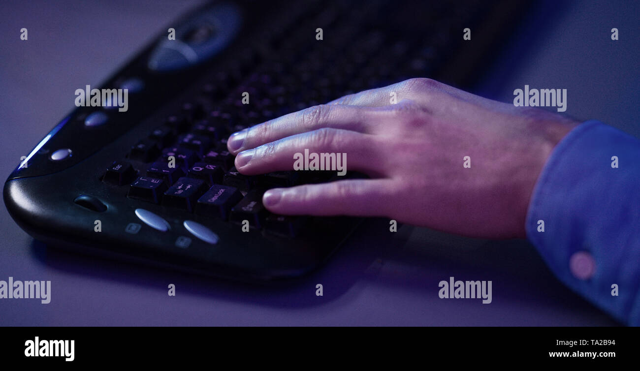 Playing Games Online. Gamer Hand On Keyboard - Stock Image