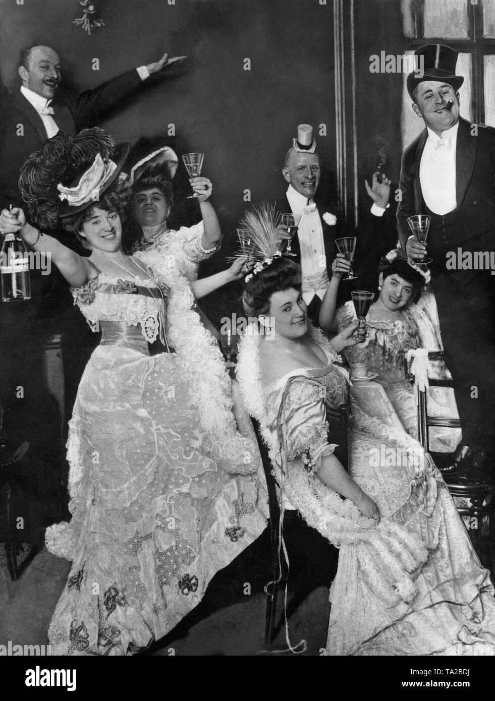 Artists (left to right): Hans Junkermann, Else von Ruettersheim, Ms Junkermann, Phila Wolff, Josef Giampietro, Fritzi Massary, Guido Thielscher celebrate New Year's Eve. - Stock Image