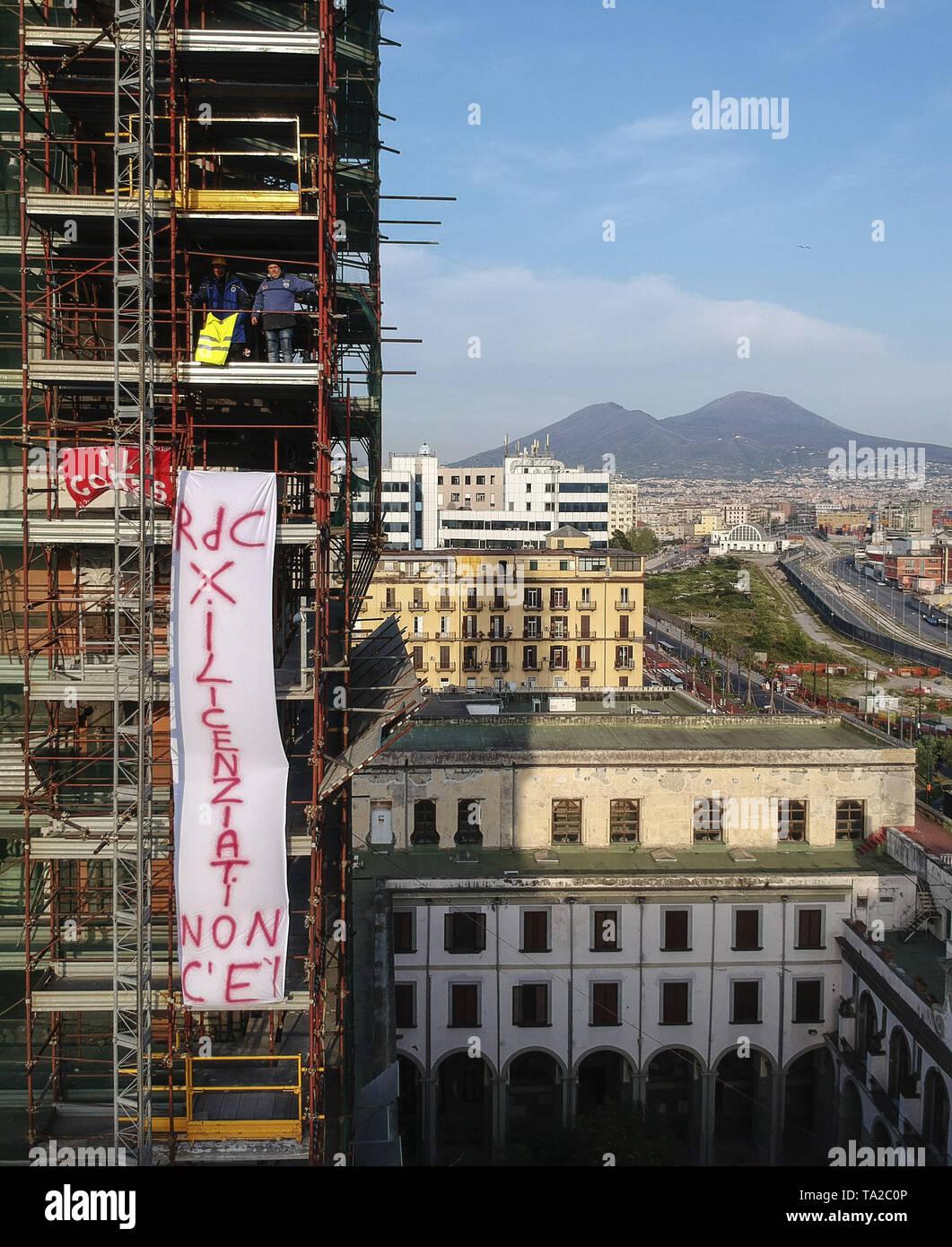 Two employees fired by the FCA after exhibiting a mannequin of Sergio Marchionne hanged at a demonstration in Pomigliano d'Arco, protest with a banner on the bell tower of the Chiesa del Carmine, in Piazza Mercato in Naples, with the inscription 'Citizenship income for laid off is not there'  Featuring: Atmosphere Where: Naples, Italy When: 20 Apr 2019 Credit: IPA/WENN.com  **Only available for publication in UK, USA, Germany, Austria, Switzerland** - Stock Image