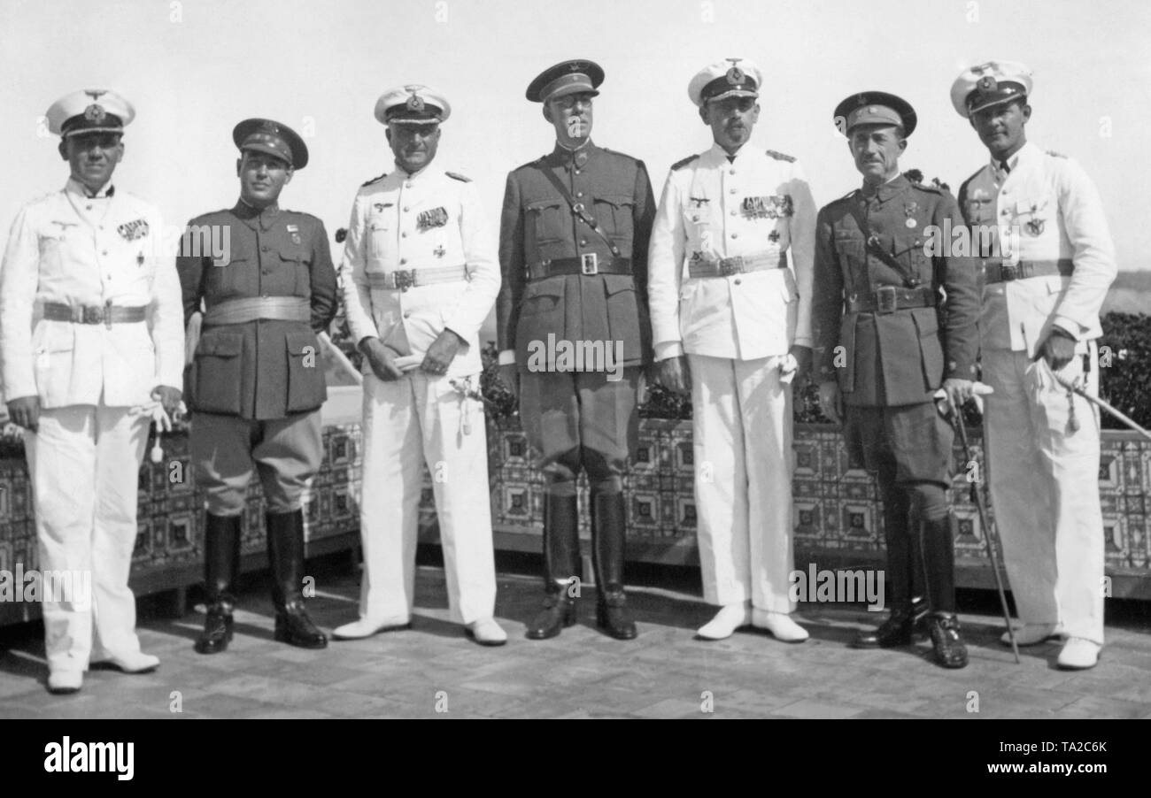 A group of German naval officers of the heavy cruiser Deutschland and Spanish officers on the terrace of the German Consulate in Larache, Spanish Morocco 1937. From left to right: Commander Otto Klueber, Capitan Carlos Calvo, Commander of Deutschland Captain Paul Fanger, Comandante (Major ) Dorrego, commander of the German naval forces in front of Spain Deputy Admiral Rolf Carls, Teniente Coronel (lieutenant colonel), Eduardo de Losas, Captain Seeliger. - Stock Image