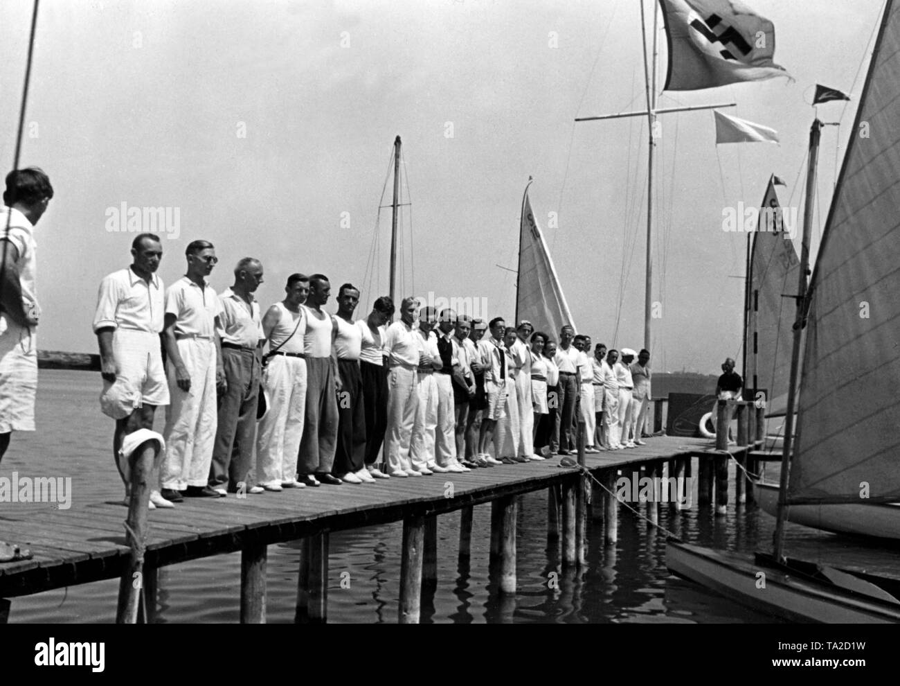 View of participants in a sailing course of the Nazi organization 'Kraft durch Freude' ('Strength through Joy') in Diessen am Ammersee. Photographer: Georg Schoedl. - Stock Image