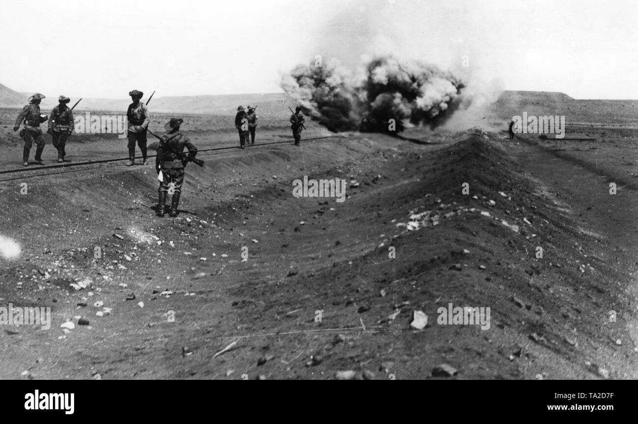 German Schutztruppen blow up the railway line Windhoek-Keetmanshoop in 1914 on the territory of the former German colony of German South-West Africa. - Stock Image