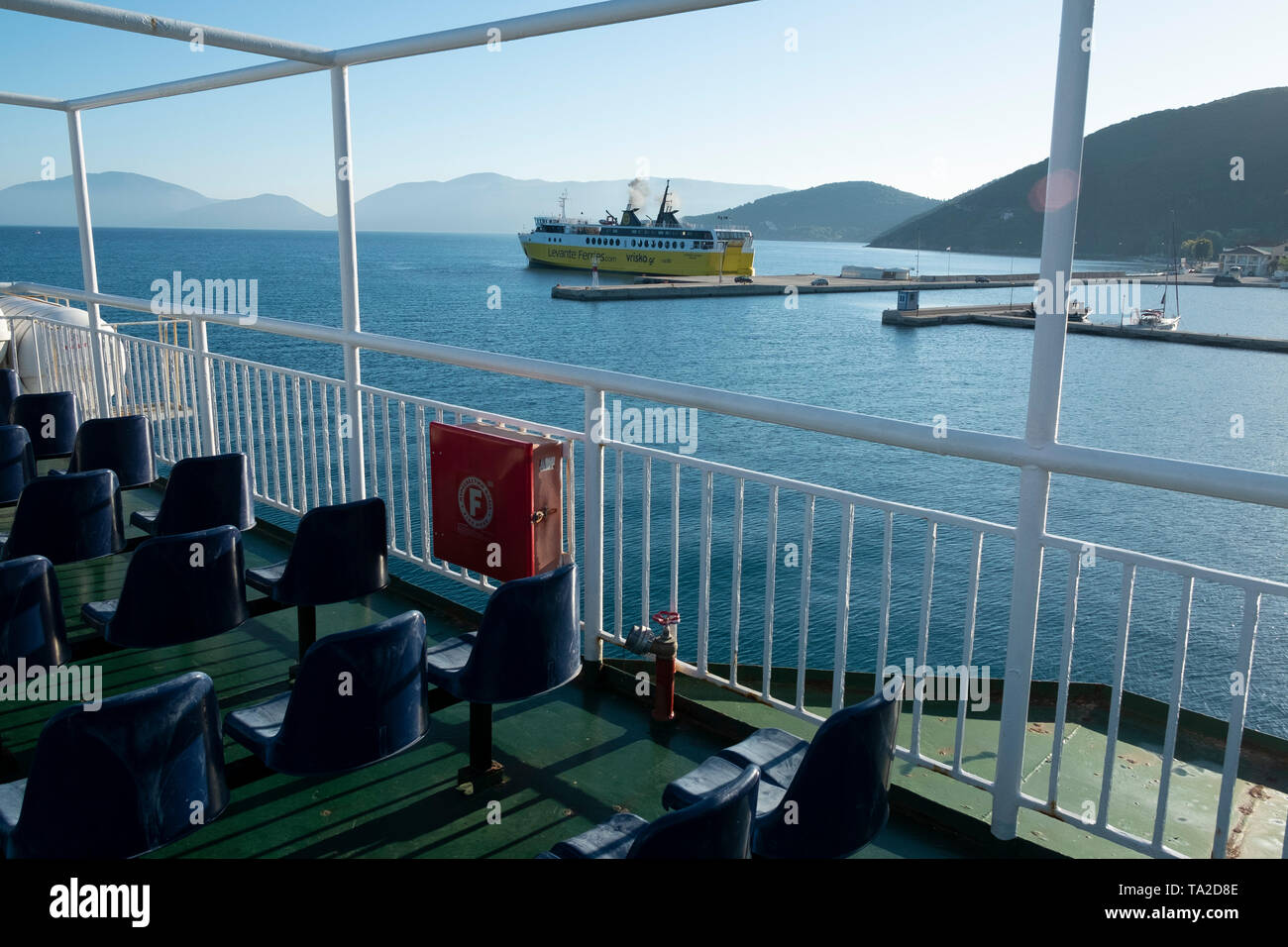 Smoke coming from the funnel of Ionian Lines ferry in Sami, Kefalonia, Greece. Kefalonia is an island in the Ionian Sea, west of mainland Greece. - Stock Image