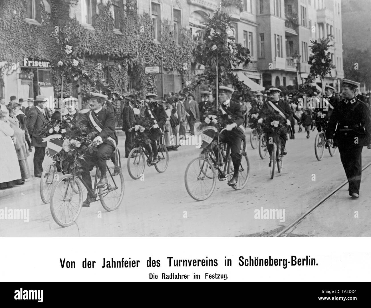 Members of a gymnastics club on bicycles at the pageant of the annual celebration in Spandau, Berlin, on October 3, 1911. Stock Photo