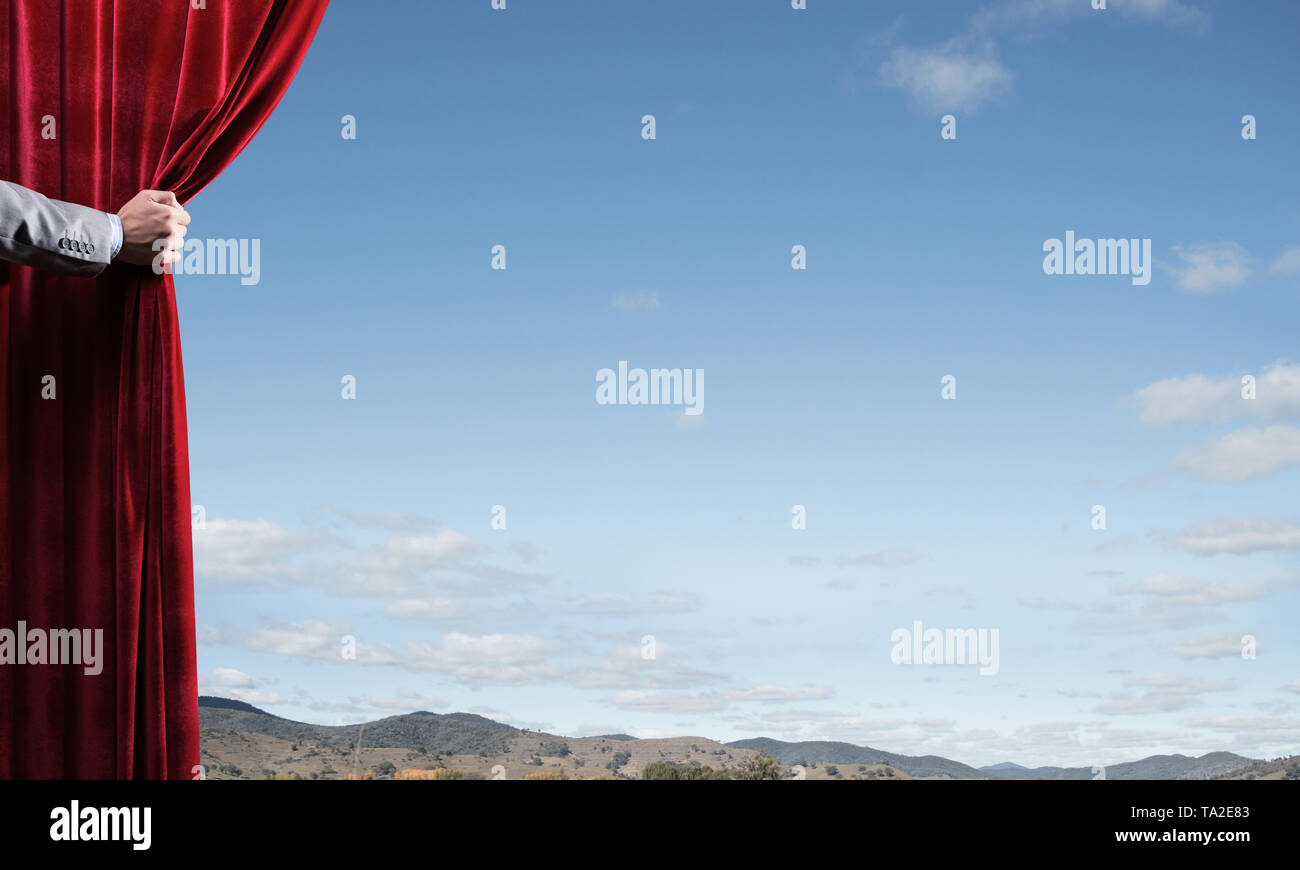 Summer natural bluesky view behind red velvet curtain - Stock Image