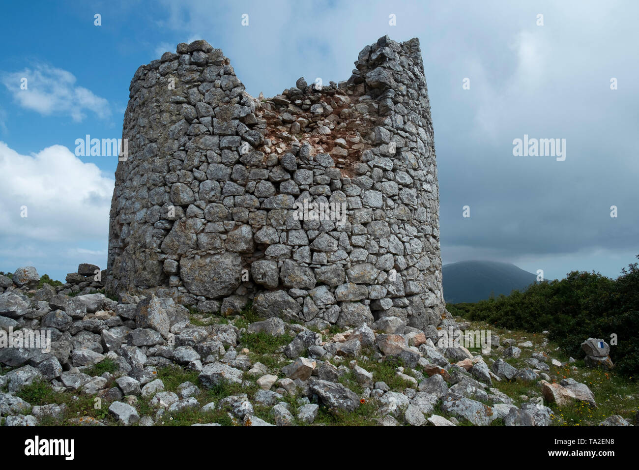 Ruins of ancient windmills around Exogi, Ithaca, Greece. Ithaca, Ithaki or Ithaka is a Greek island located in the Ionian Sea to the west of continental Greece. Ithacas main island has an area of 96 square kilometres. It is the second-smallest of seven main Ionian Islands. - Stock Image