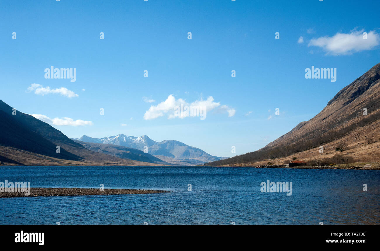 Looking from Glen Etive at the head of Loch Etive towards snowcapped Ben Cruachan in the distance. This tidal sea loch runs south for 31km to Connel - Stock Image