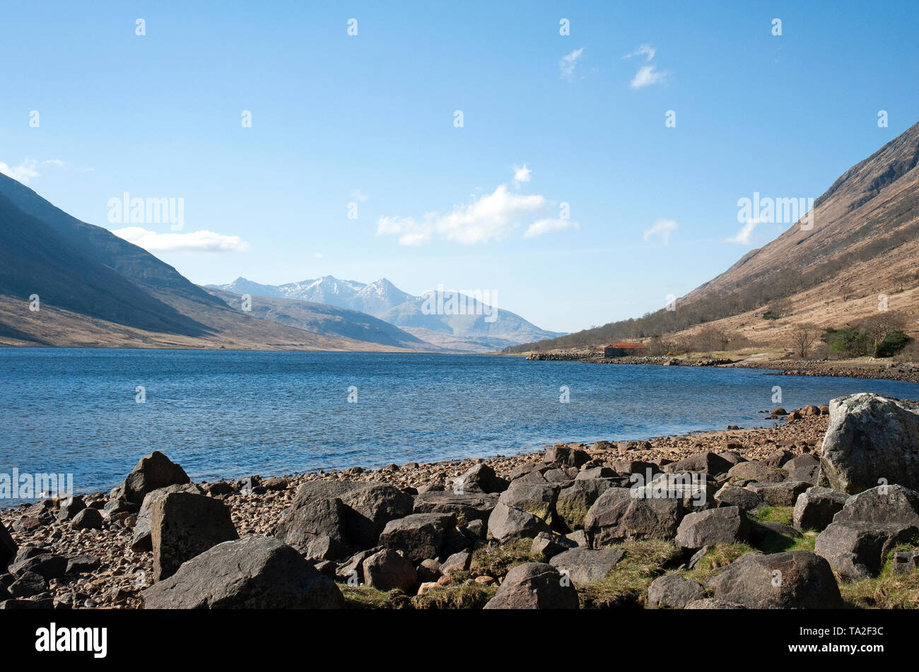 This sea loch runs for 31km from Glen Etive at the head of Loch Etive, beyond the snowcapped Ben Cruachan in the distance, to Connel. - Stock Image