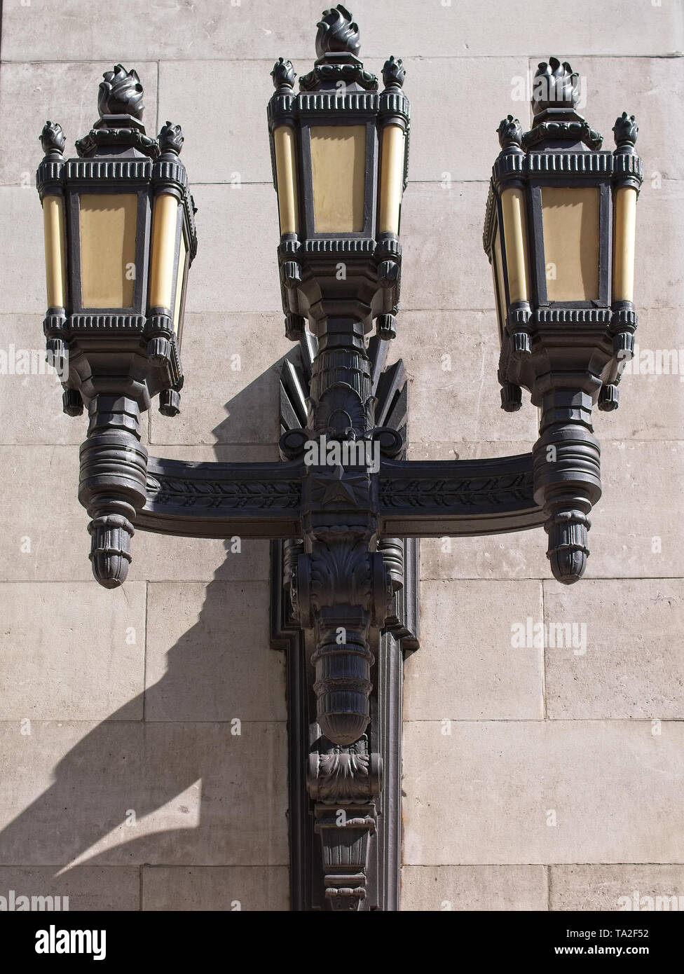 Black cast iron lanterns on the wall of the Freemason Hall, the United Grand Lodge and Supreme Grand Chapter of Royal Arch Masons of England. - Stock Image