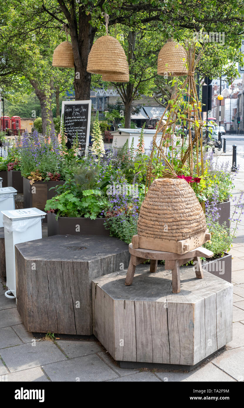 Floral display outside Daylesford organic shop for Chelsea in Bloom 2019 in Pimlico Road. Belgravia, London, England - Stock Image