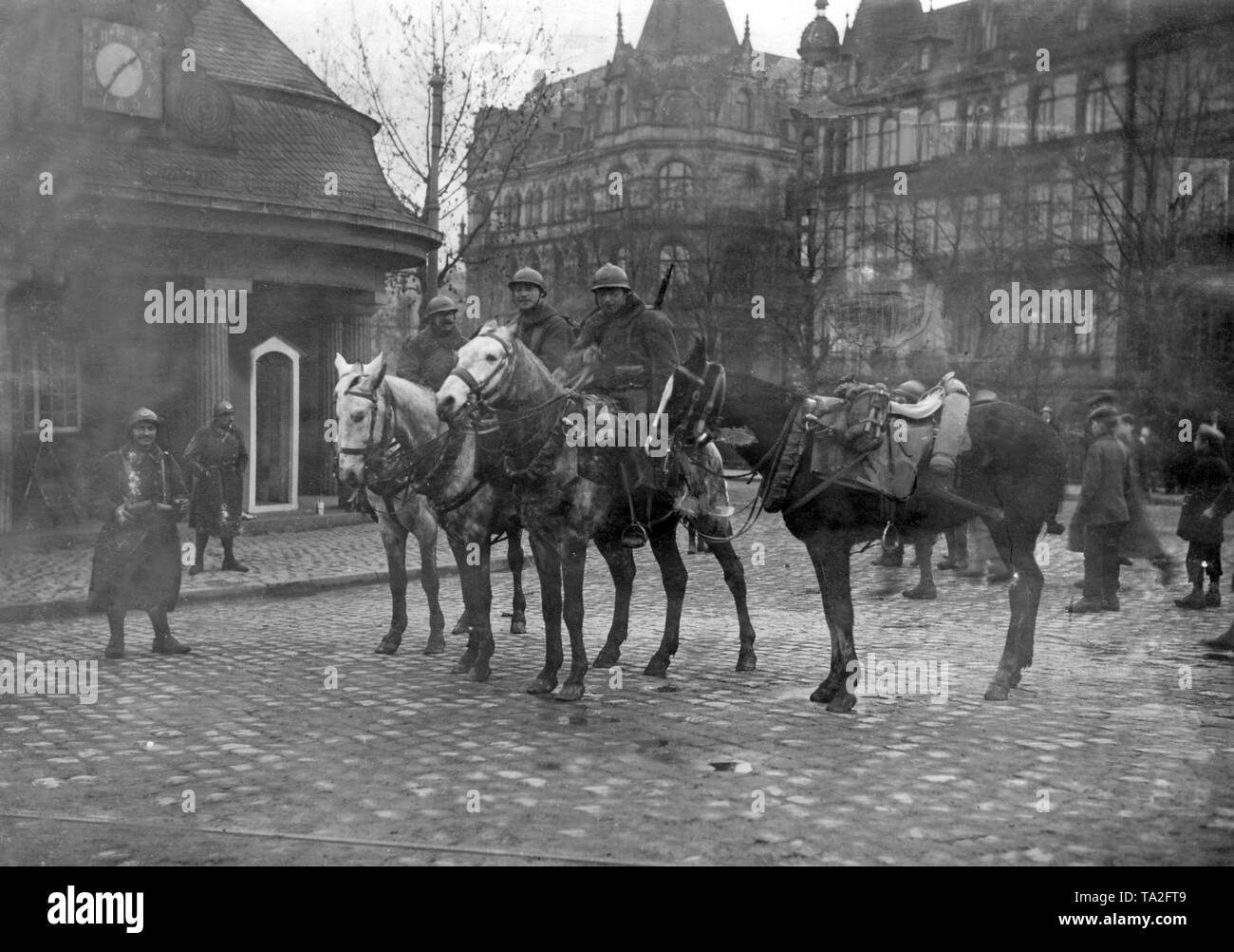 According to the Treaty of Versailles, French troops occupied the Rhineland. French cavalrymen on the streets of Mainz. - Stock Image