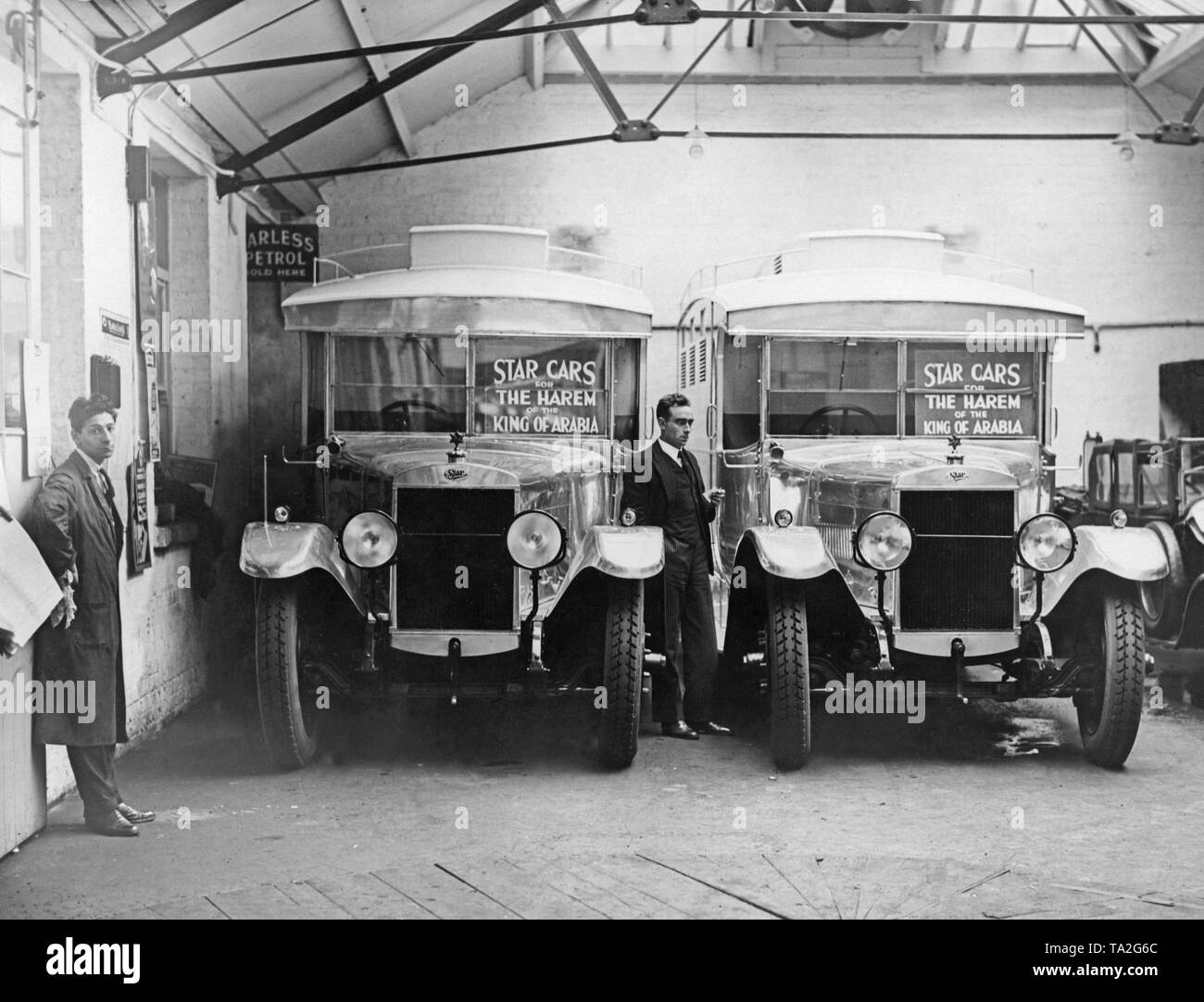 Two cars are waiting in a garage to be used by the harem of Saudi king Abd al-Aziz ibn Saud during his visit to London. The Star Motor Company has manufactured the cars for the King. They do not have windows but a closed passenger compartment with ventilation slots. - Stock Image