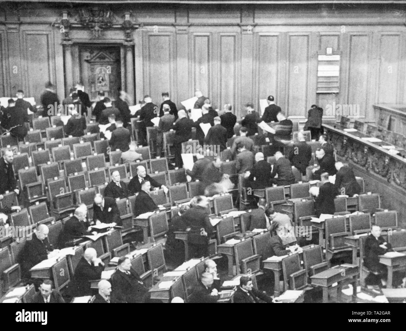 During the speech of Dr. Loewenthal, the fractional members of the NSDAP demonstratively turned their backs on the speaker. Only Vice-President Franz Stoehr (far right) is looking at the lectern, Joseph Goebbels (right half of the picture, with his head resting on his arm) writes something on the bench of the person sitting behind him. Stock Photo