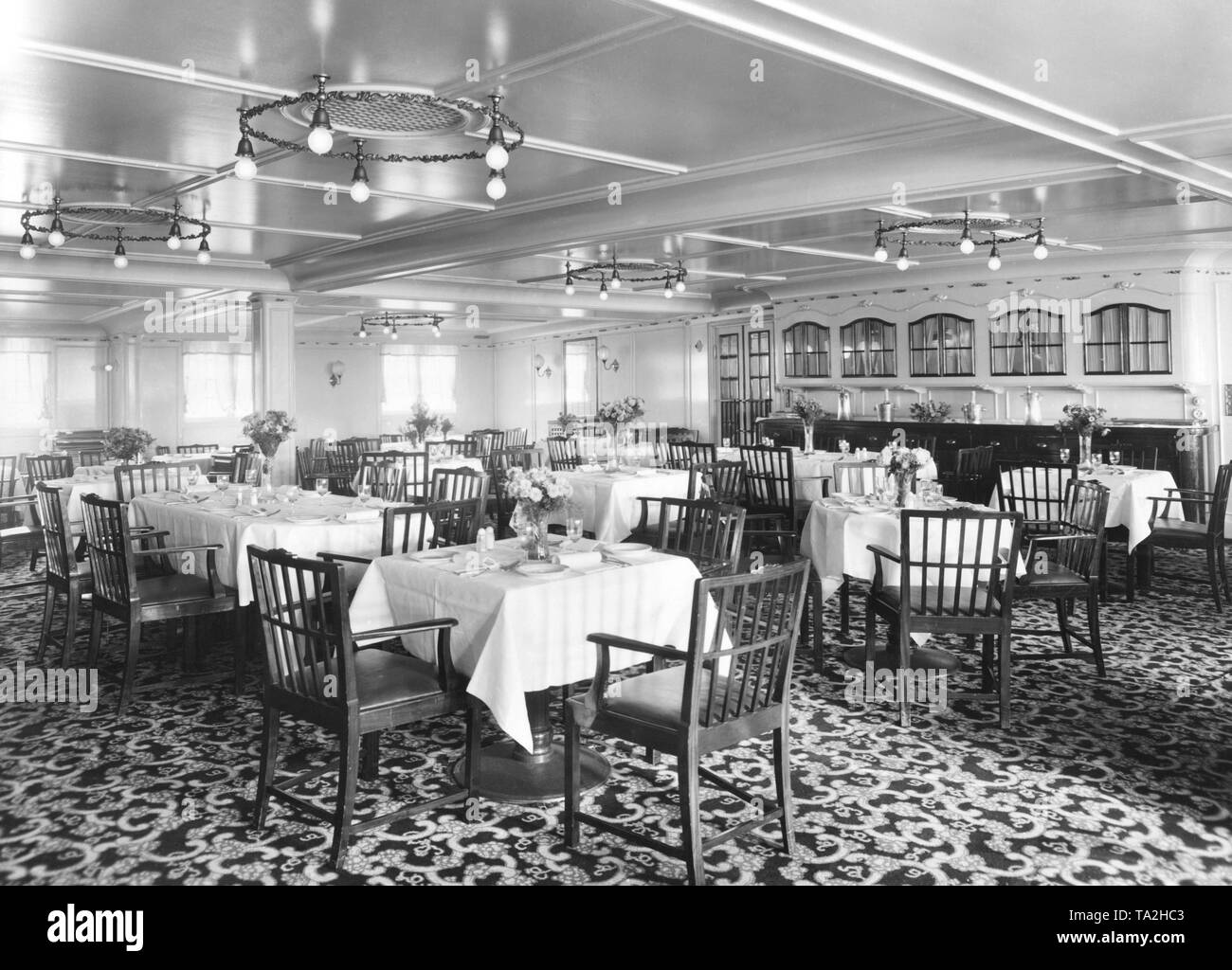 The dining room of the middle class of the passenger steamer 'General San Martin'. - Stock Image