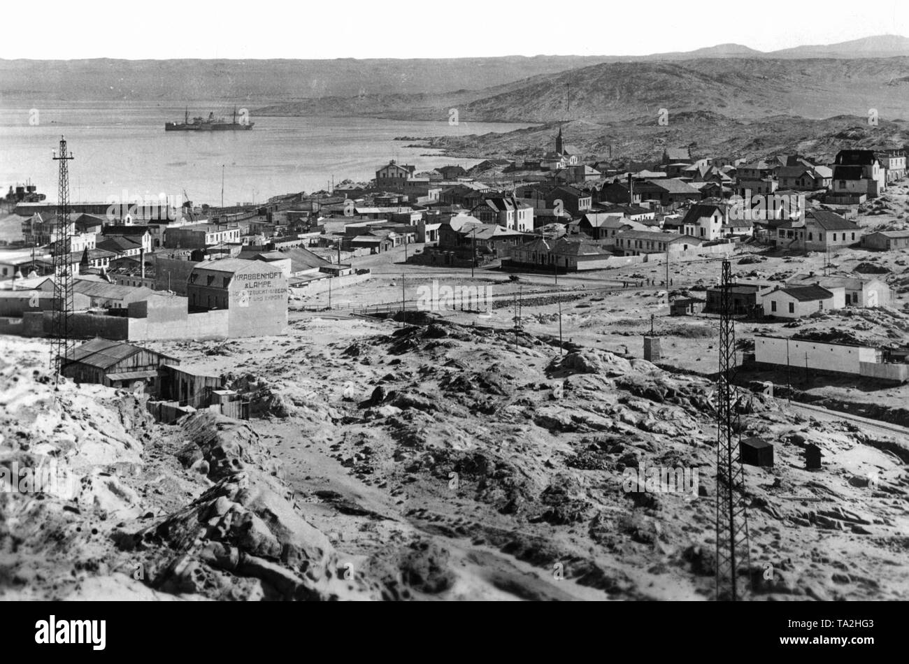 View from the interior to the coastal town of Luederitz Bay, the former German colony of German South West Africa. In the background is the sea. - Stock Image