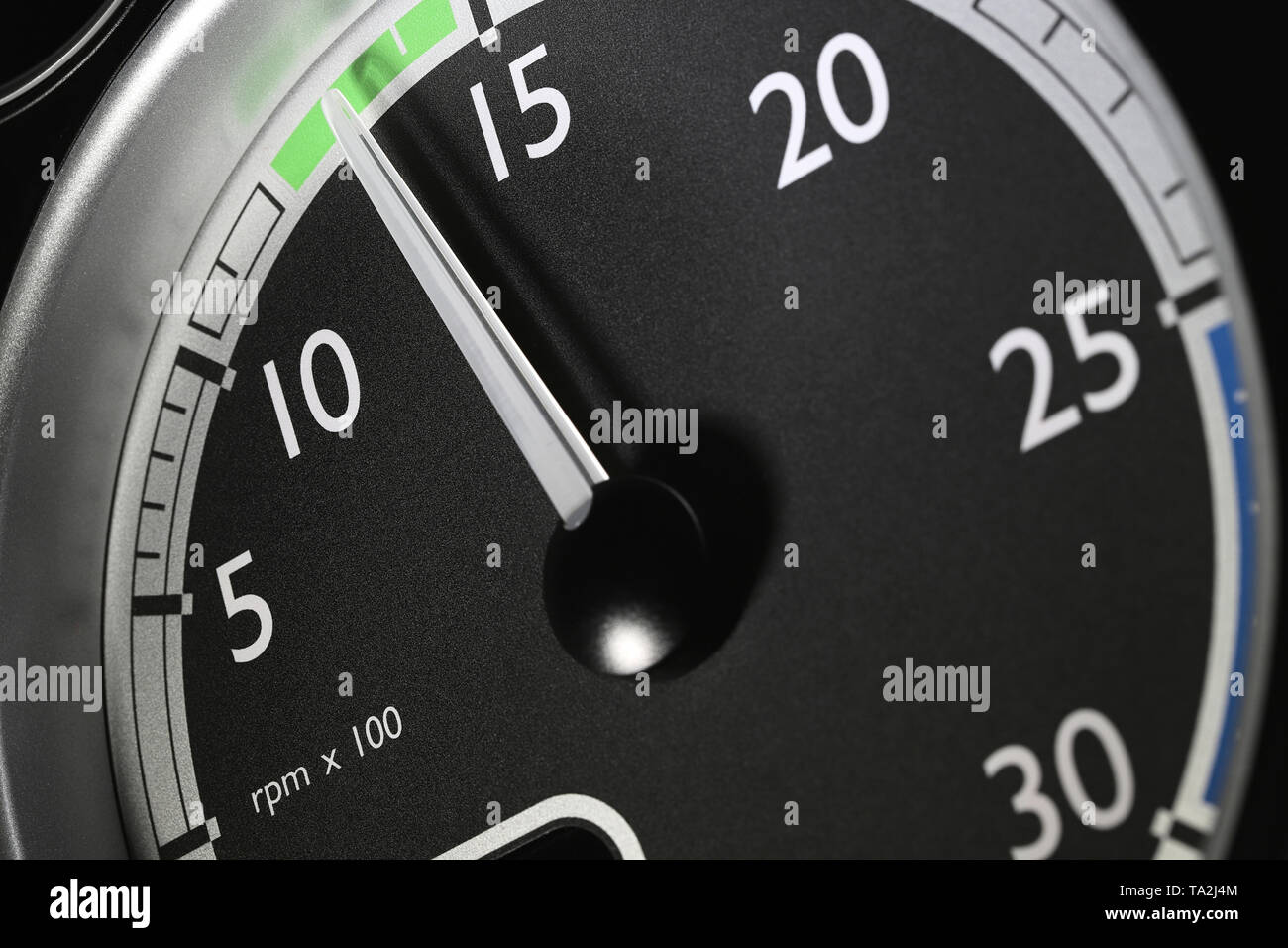 tachometer of a truck at economic mode of operation - Stock Image