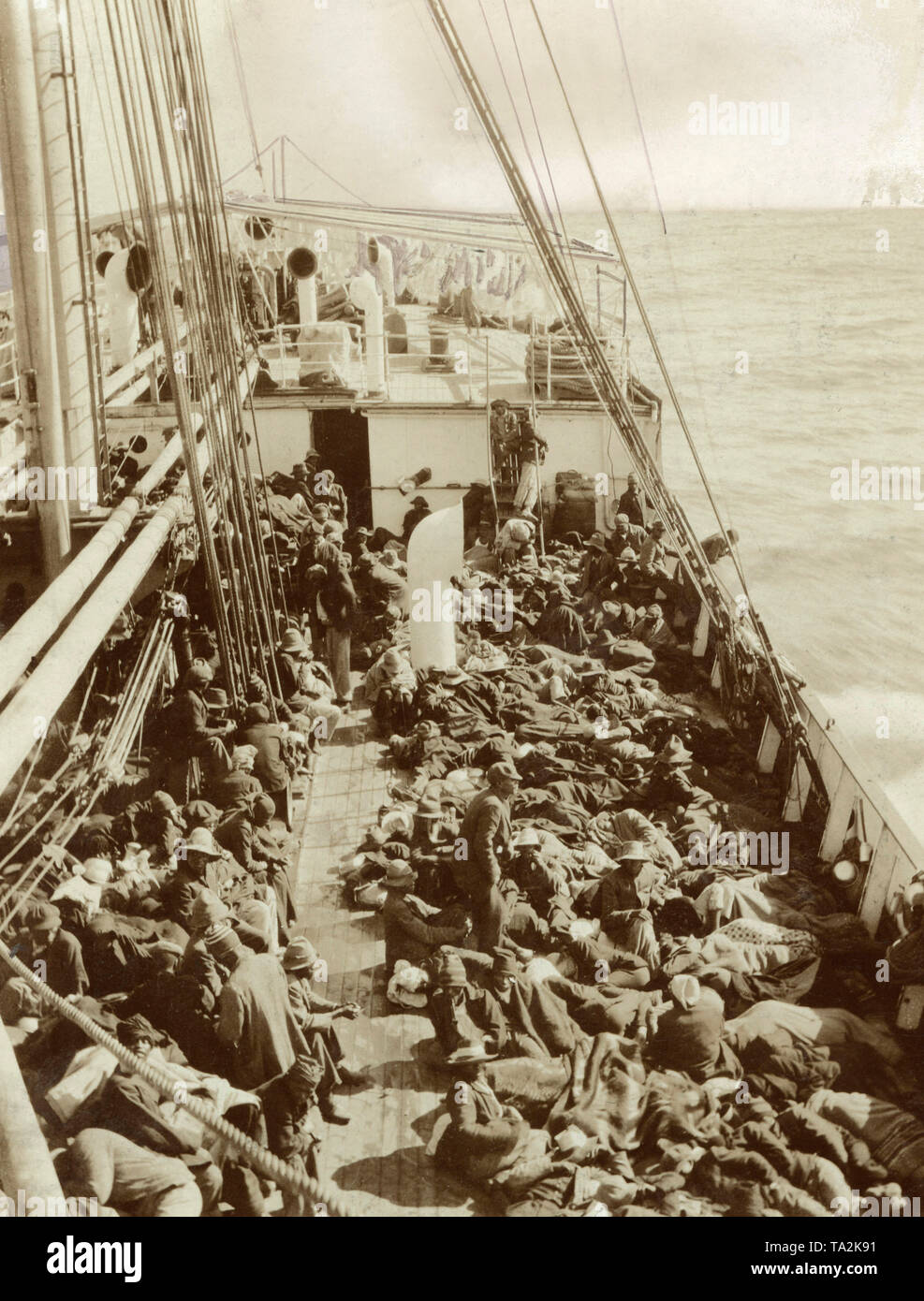 A ship transports local workers to Swakopmund, German South West Africa. - Stock Image