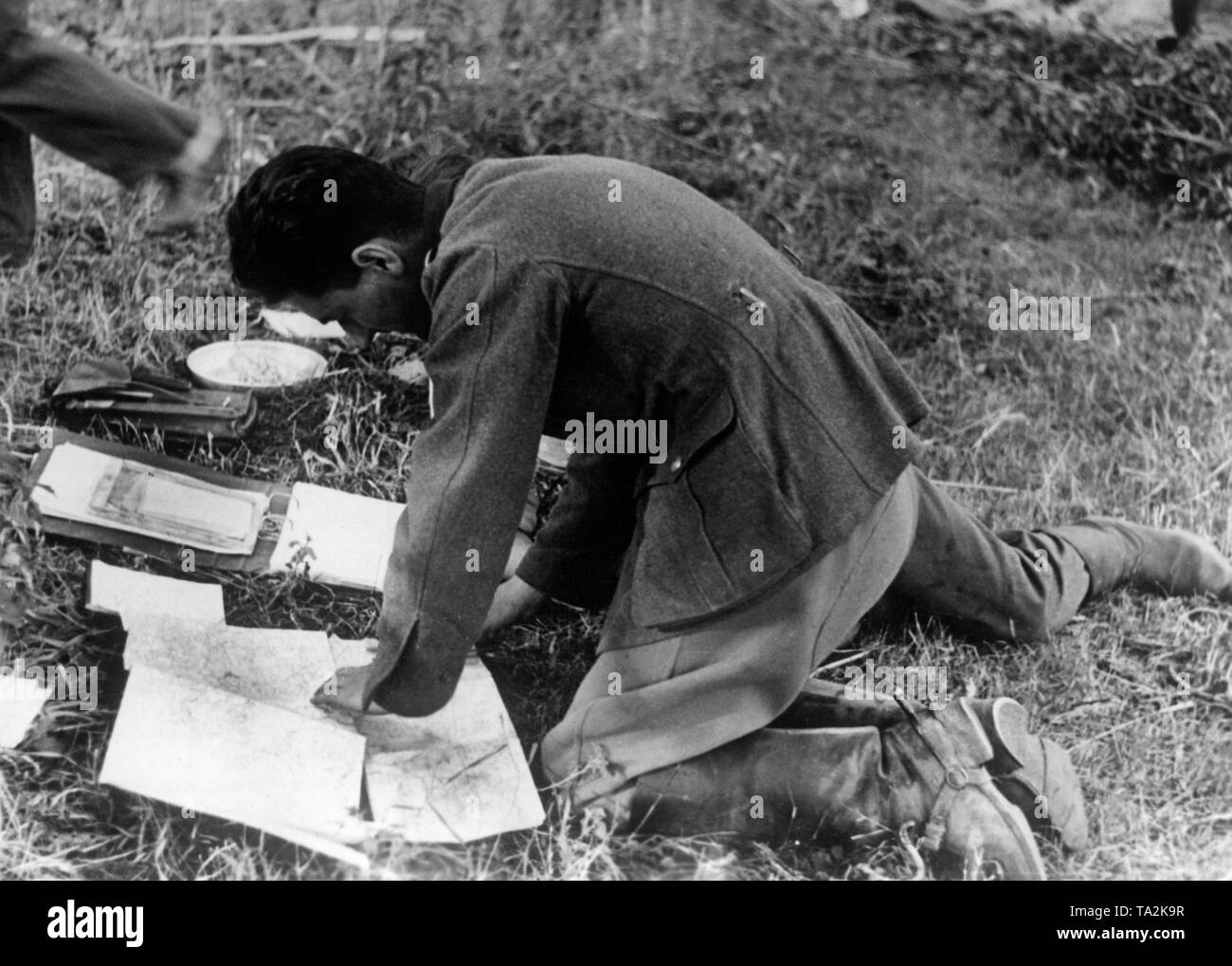 A German Wehrmacht soldier studies maps at Holynka in today's Belarus in the area of Army Group Center. Photo: war correspondent Knobloch. Stock Photo