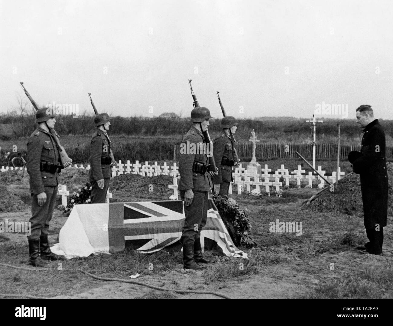 An English officer, who fell during the fighting in the north of France, was buried with military honors by German soldiers. A captured Englishman speaks a prayer. Stock Photo