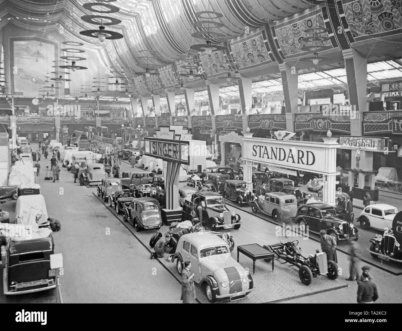 Overview of an exhibition hall of the British International Motor Show. - Stock Image