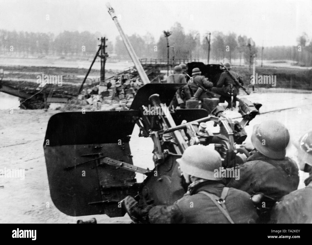 A light 2-cm-Flak 38 secures the attack points of the infantry. In the background a 3rd7 cm-PaK 36 of the Wehrmacht. Stock Photo