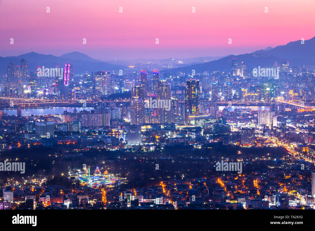 Seoul City and downtown at Night, South Korea - Stock Image