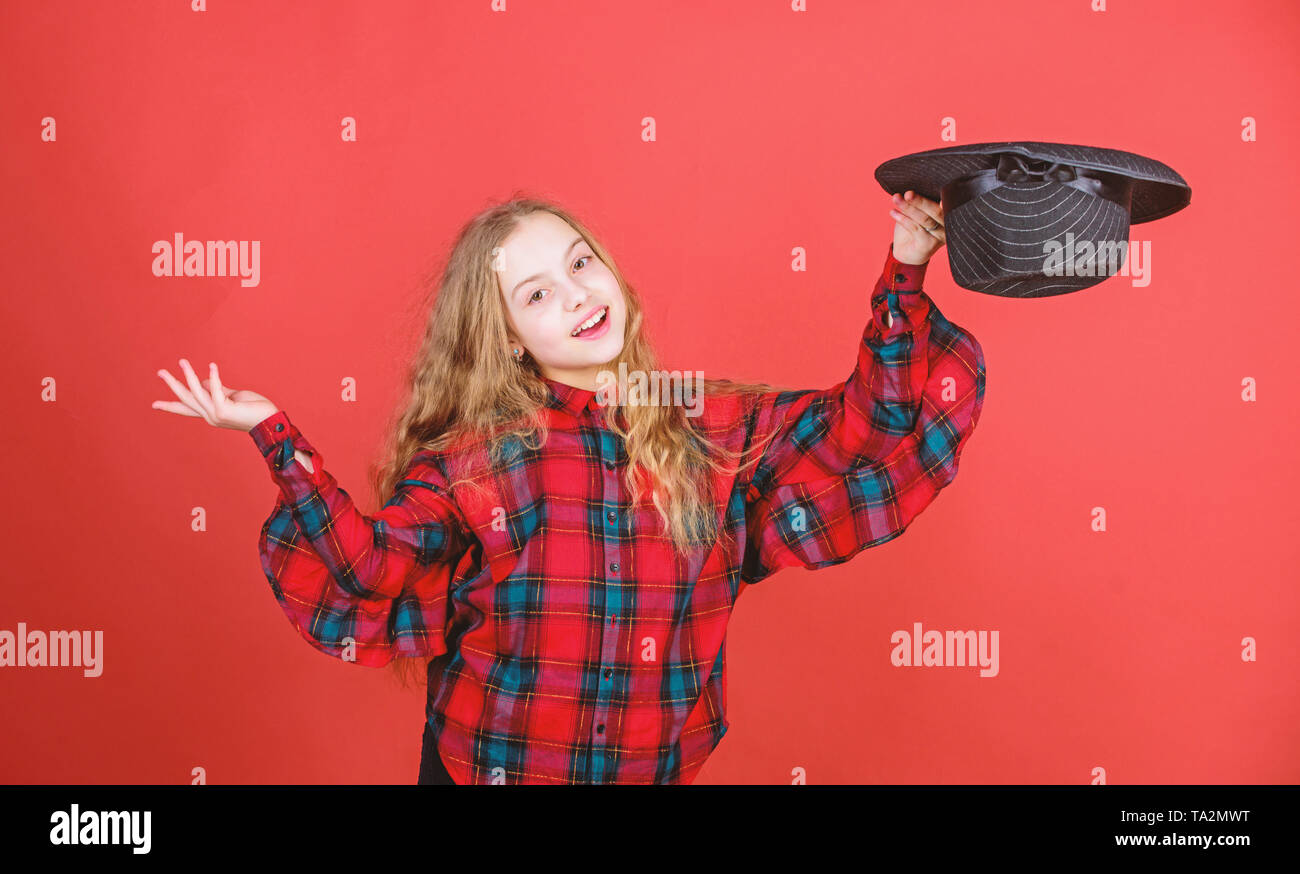 Acting school for children. Acting lessons guide children through wide variety of genres. Develop talent into career. Enter acting academy. Girl artistic kid practicing acting skills with black hat. - Stock Image