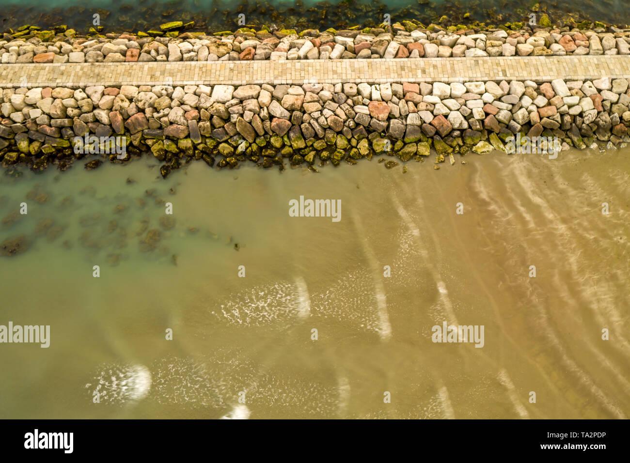 lignano sabbiadoro beacon lighthouse, piece of pier in long exposure. Perfect for your desktop photo - Stock Image