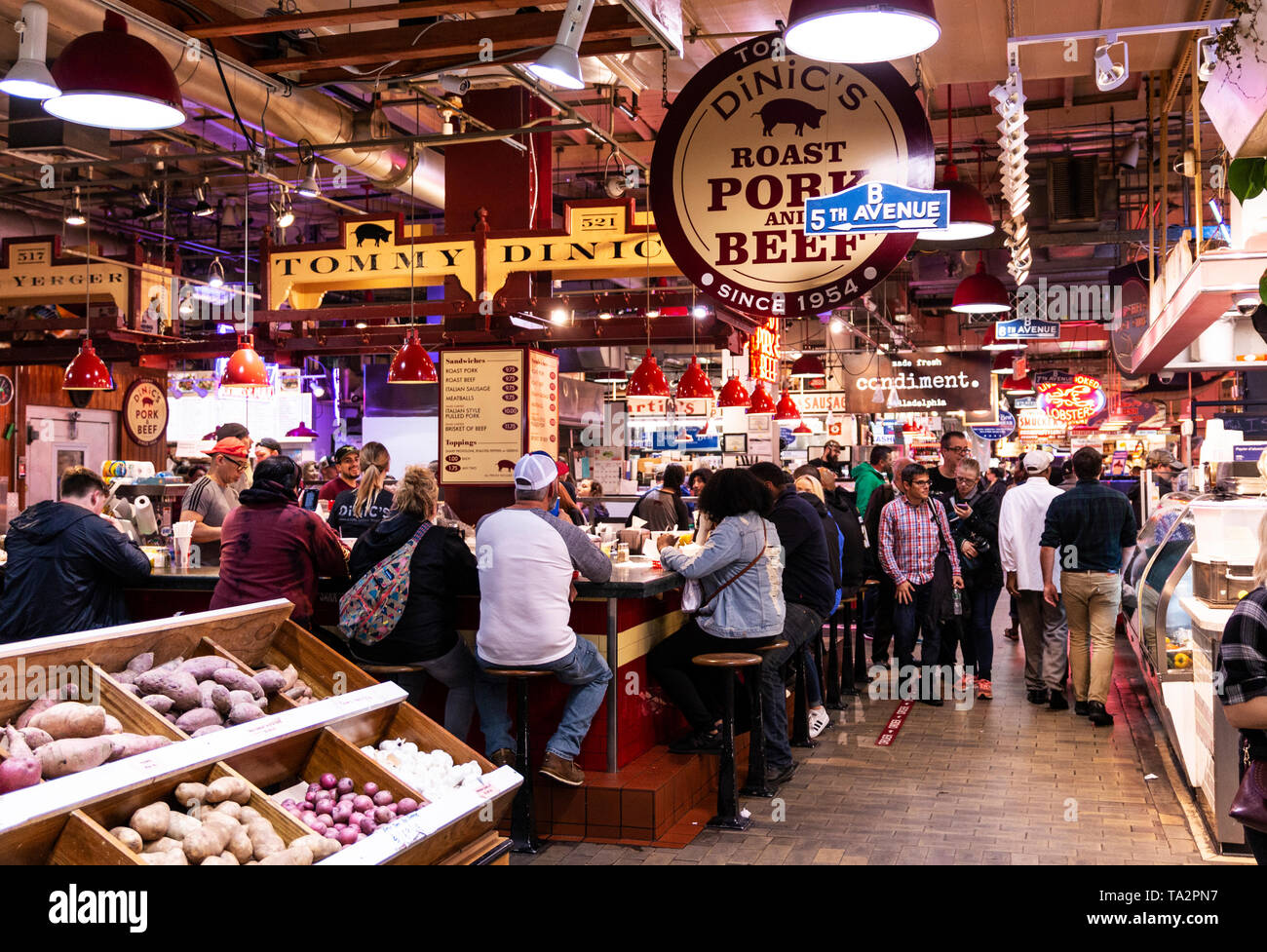 Philadelphia, Pennsylvania - 26 April 2019: Customers sitting at a counter and customers walking around purchasing food and other produce at the Readi - Stock Image