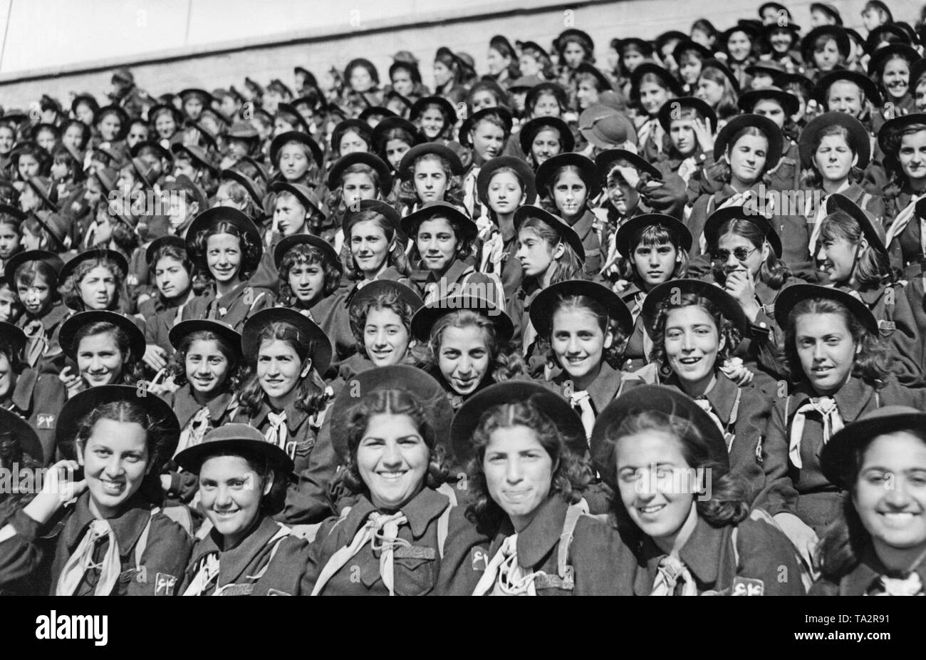 Iranian girl scouts at an event in a stadium. - Stock Image