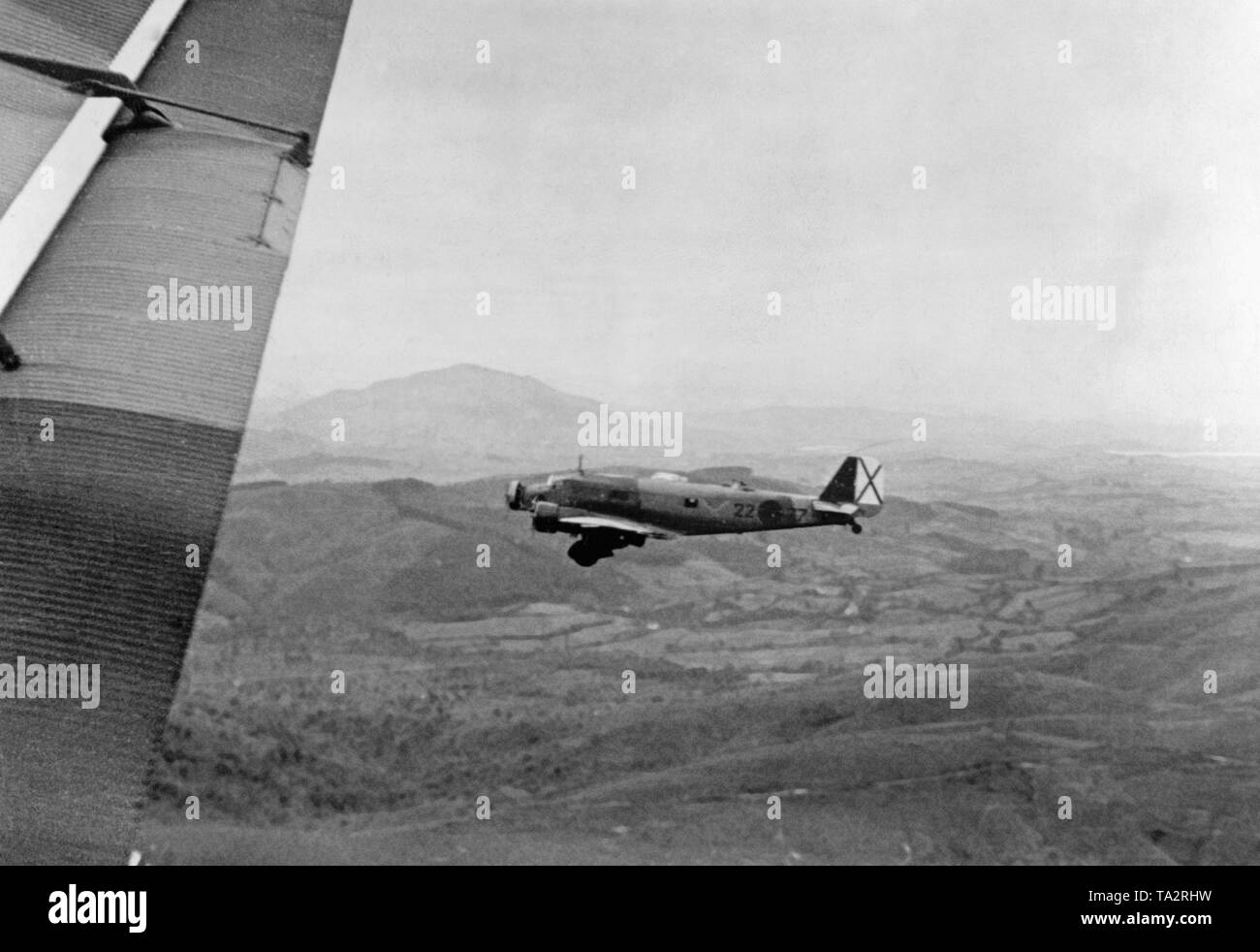 The photo shows a German Junkers Ju 52 transport aircraft with the paintwork of the German Condor Legion loaded with Moroccan soldiers on the flight from Tetouan, Spanish-Morocco, Africat to the Spanish mainland in the summer of 1936. After the outbreak of the Spanish Civil War on July 27, 1936, Germany provided military assistance to General Franco (Operation Feuerzeauber). In addition, 20 Ju-52s (mostly Lufthansa aircrafts) were provided, which flew more than 800 flights of Spanish national troops, including 14,000 Moroccan foreign legionaries (Fuerzas Regulares Indigenas), and materials - Stock Image