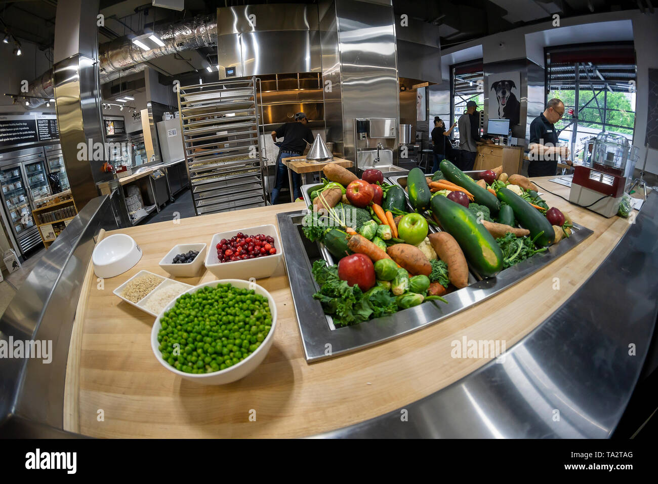 The JustFoodForDogs dog food kitchen is seen inside the Petco store in Union Square in New York on opening day, Friday, May 10, 2019. The ninth kitchen for the Southern California brand, it is their first on the East Coast. The 2000 pounds of fresh dog food it will produce each day is human-grade and nutritionally balanced for your dog. (© Richard B. Levine) - Stock Image