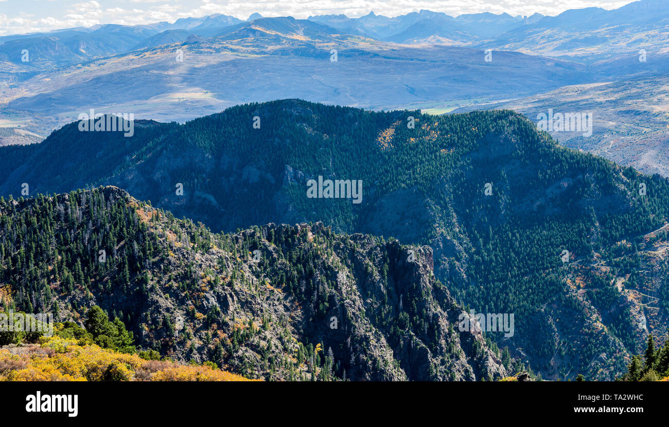 Autumn Mountain Ranges - Panoramic autumn view of layers of rolling mountain ranges in Colorado Rockies, as seen from Colorado Highway 92. CO, USA. - Stock Image