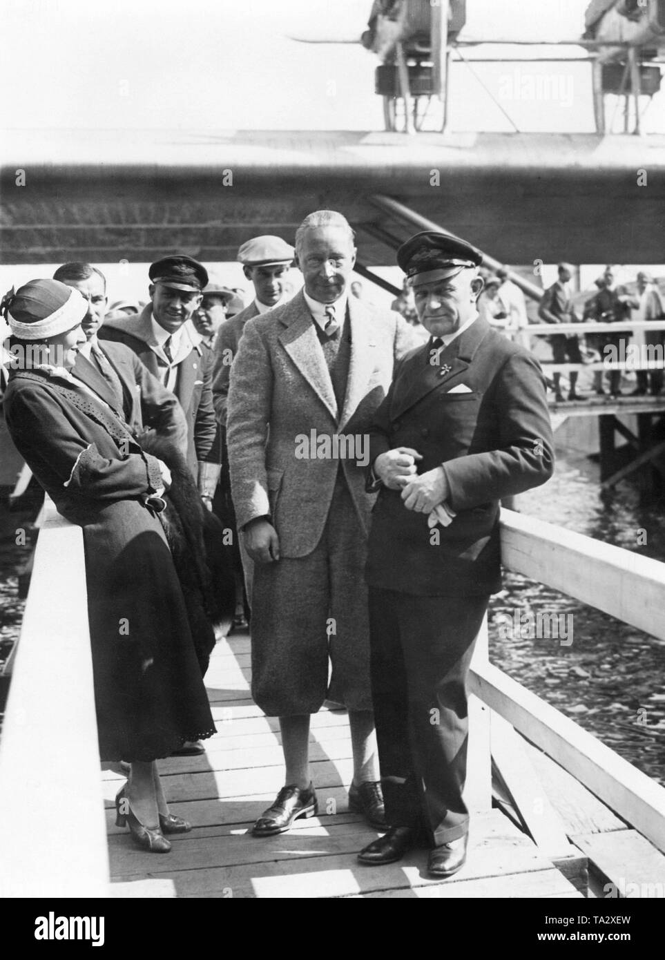 Crown Prince Wilhelm (2nd from right) looks at a Dornier DO-X airliner. - Stock Image
