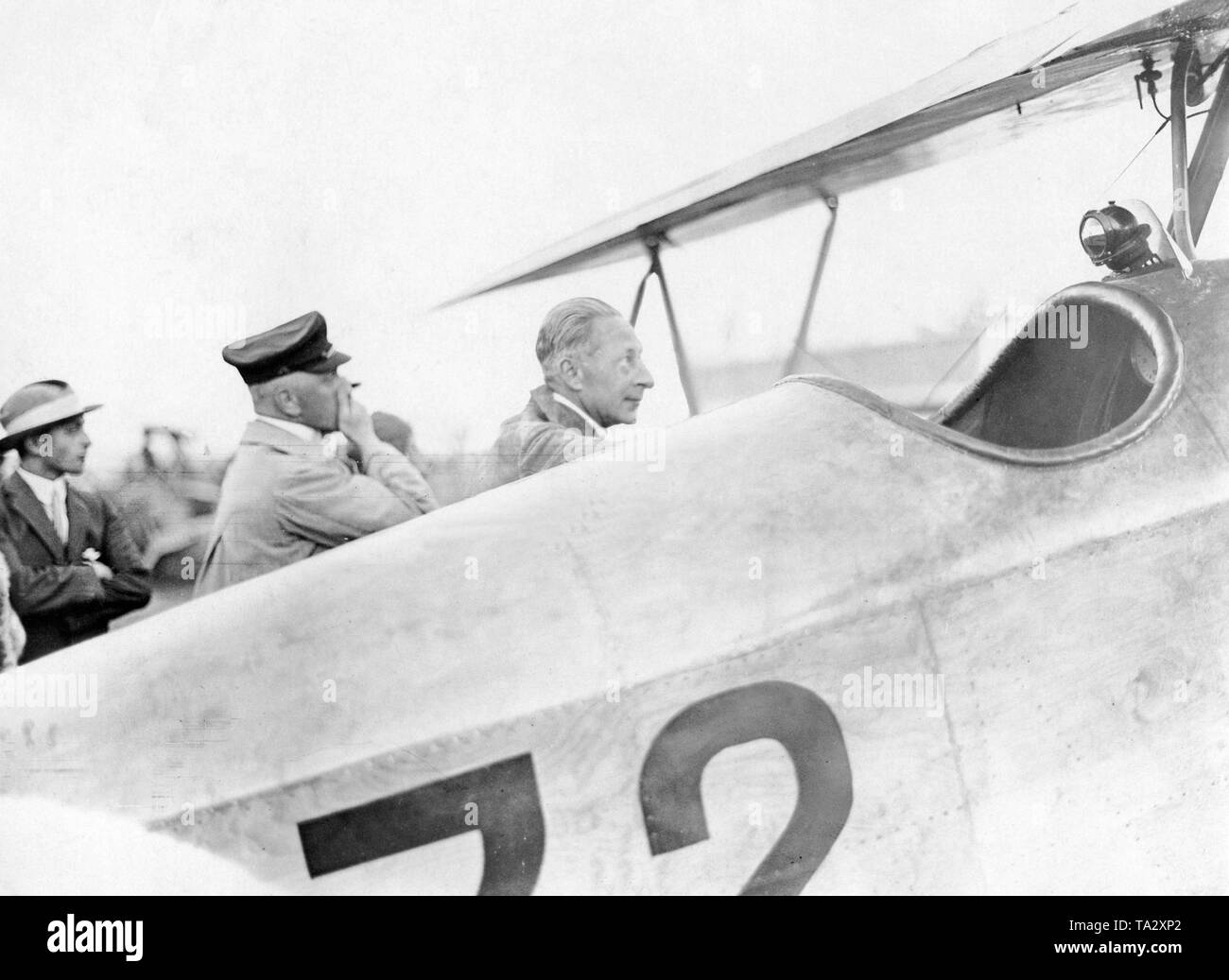 Crown Prince Wilhelm (right) looks at one of the aircraft shortly before the its take off at the Deutschlandflug (Deutsche Rundflug) competition. - Stock Image