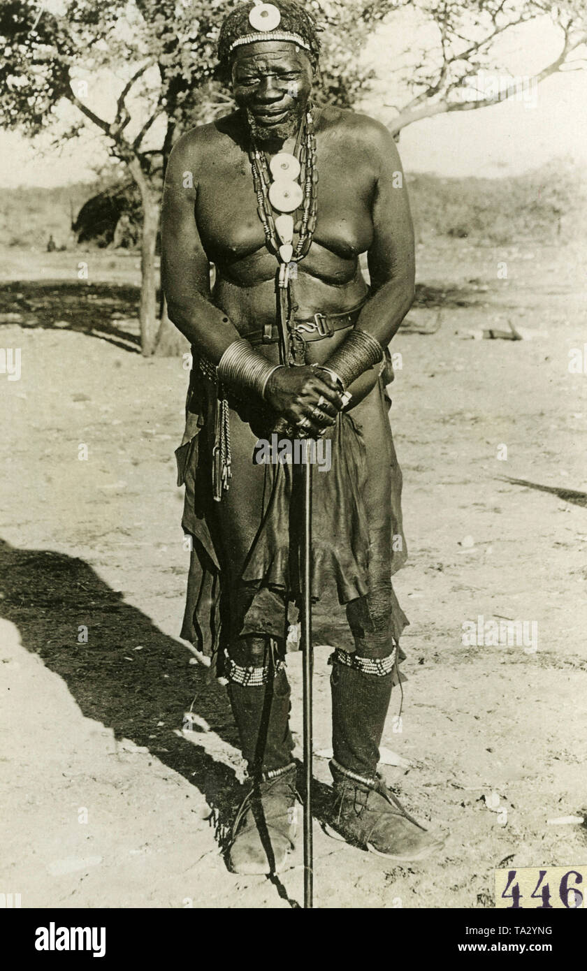 Herero chief Banjo / Bandju of Otjombonde in costume in German Southwest Africa. - Stock Image