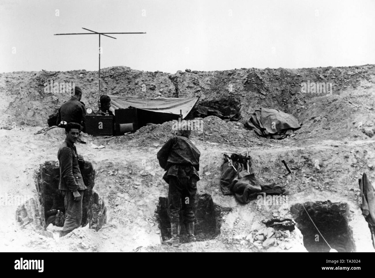 A regiment command post of the Waffen-SS on the eastern front in an antitank ditch, which the Wehrmacht had taken over from the Red Army. Photo: war correspondent Wiesebach. Stock Photo