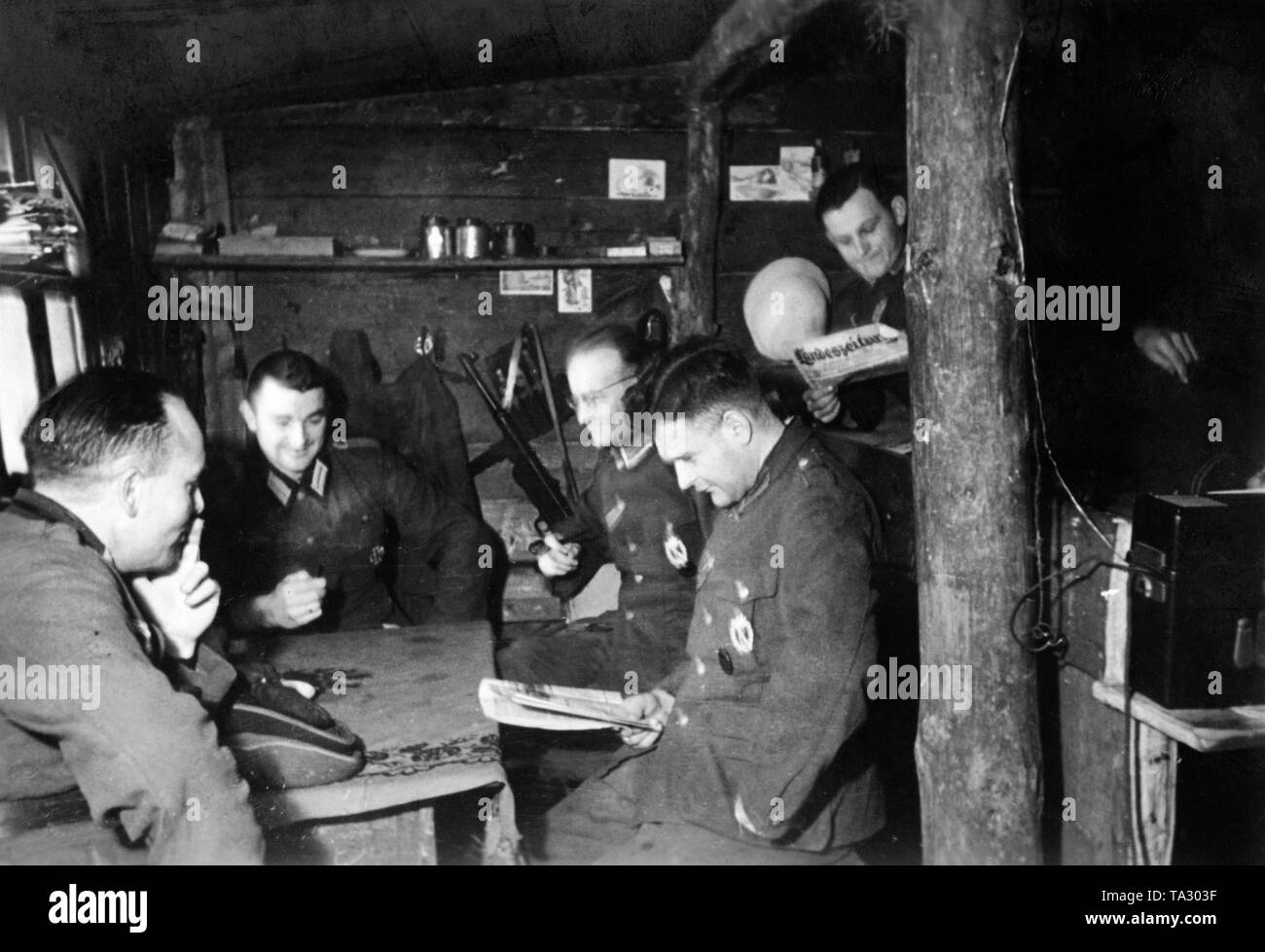 Officers of the Wehrmacht, presumably the Army Group North, in a bunker near Suchaja Wetoschj in the region of Demyansk. Photo: war correspondent Fenzke. Stock Photo