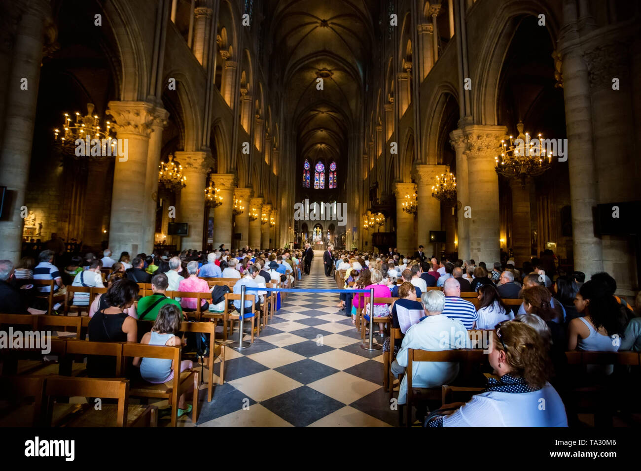 PARIS, FRANCE - 8 JUNE 2014: Unidentified tourists visiting Notre Dame de Paris - Stock Image