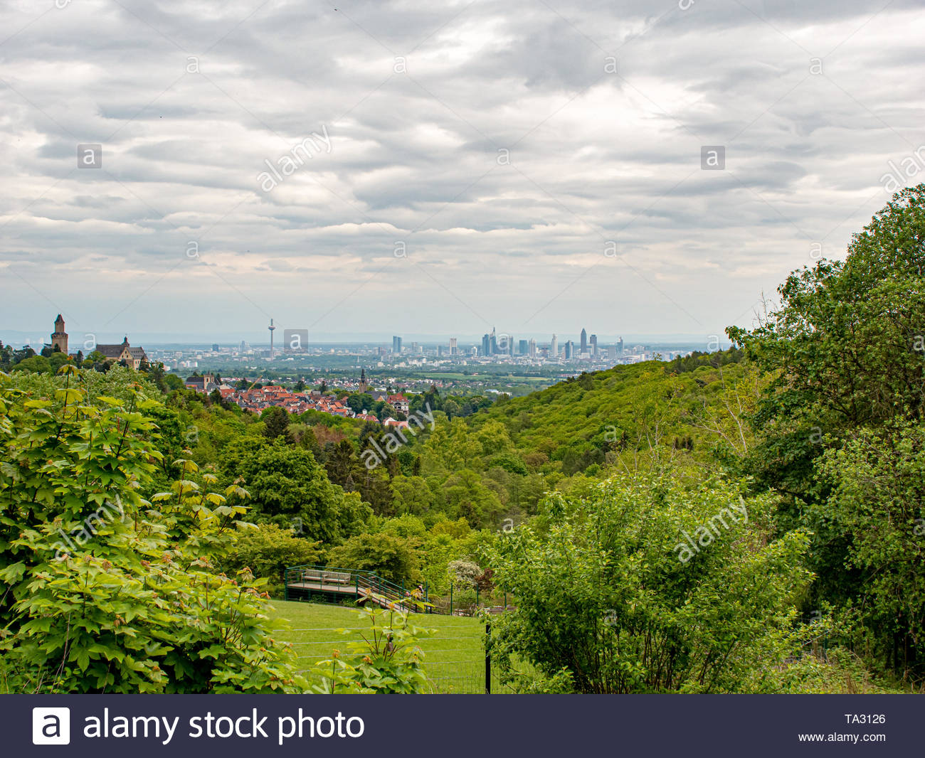 in the distance a visible silhouette of skyscrapers of a big city - Stock Image