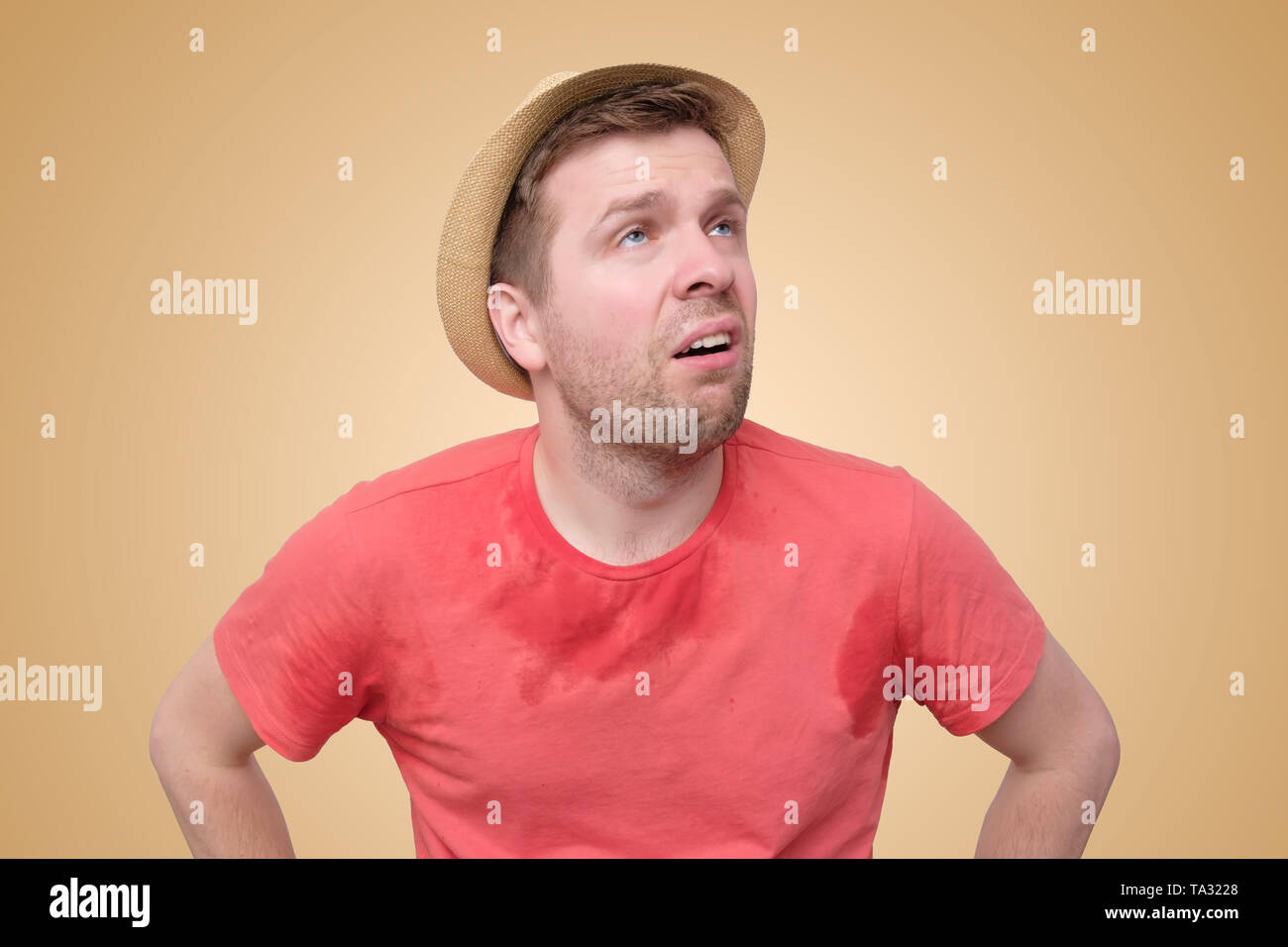 Man is worried and tired because of sweating stain - Stock Image