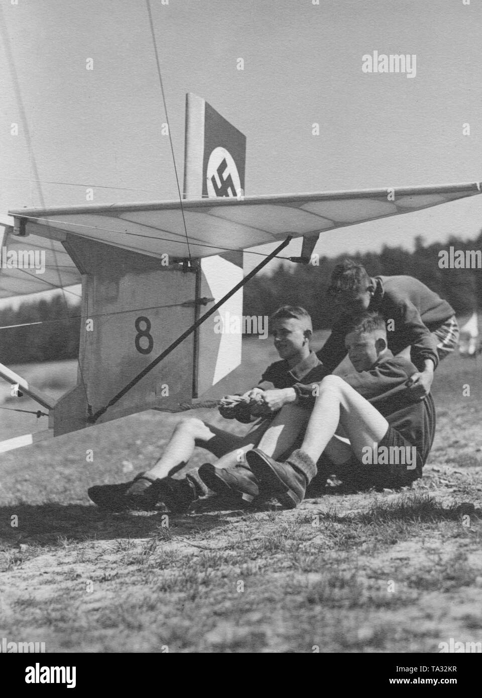 Hitler Youth members secure a glider in the gliding school Harsberg in Thuringia before takeoff. - Stock Image