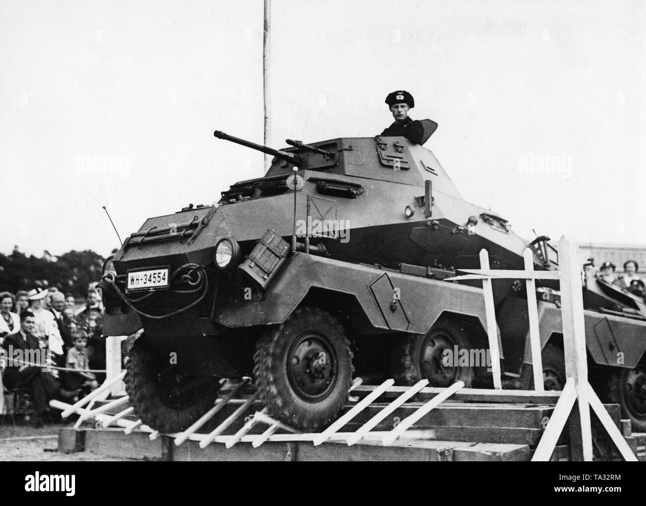An armored car of the type Sd.Kfz.231 (8 wheeled) overcomes an obstacle during a military review. The demonstration took place at the tradition takeover of the 1st Garde-Ulanen-Regiment by the 3rd Squadron of the 4th (Prussian) Cavalry Regiment, later 3rd Reconnaissance Detachment. - Stock Image