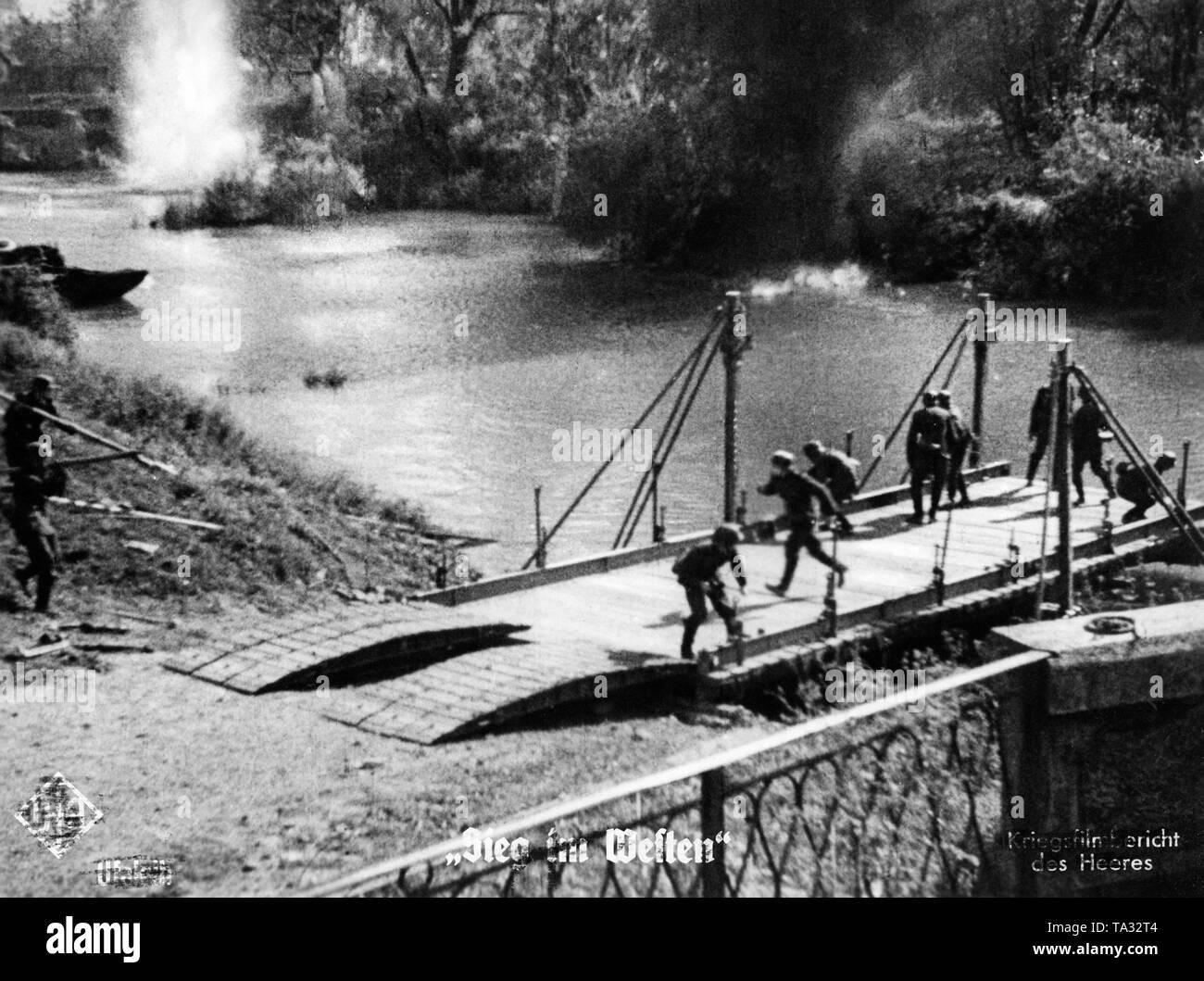 German pioneers build a bridge under enemy fire. Moviestill from Sieg im Westen (Victory in the West). Stock Photo