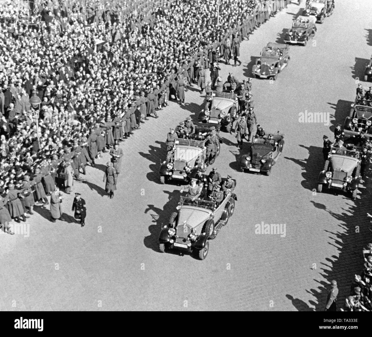 Adolf Hitler arrives on Heldenplatz in Vienna. There he announces the annexation of Austria to the German Reich. - Stock Image