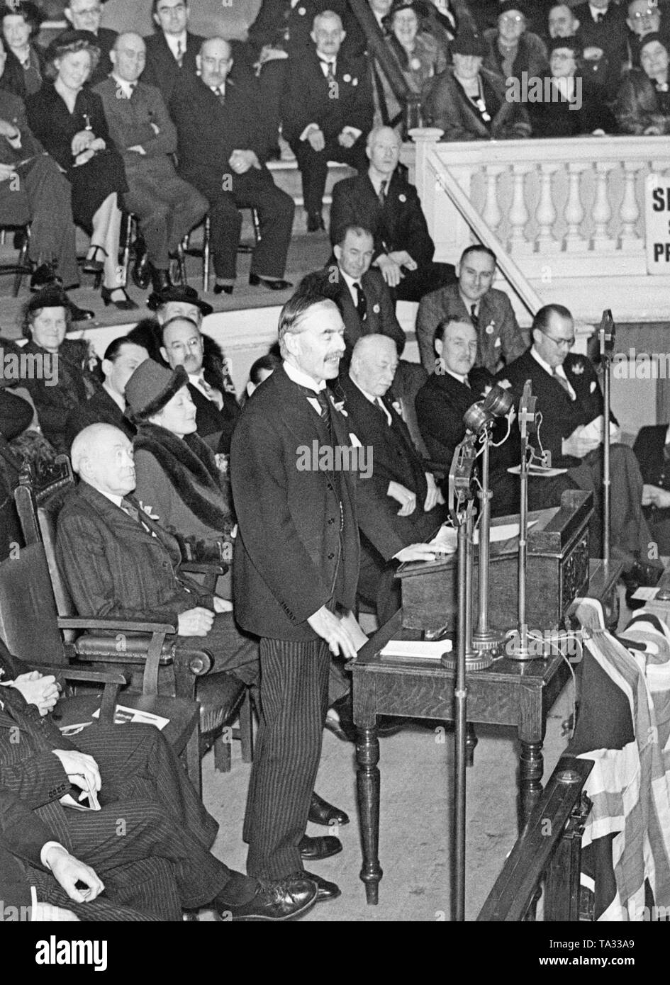 British Prime Minister Neville Chamberlain gives a speech at the