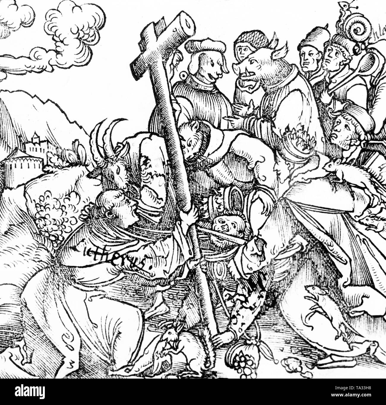 Martin Luther directs the cross against his opponents, who are represented as animals. This satirical work of an anonymous artist is aimed directly against the Pope. - Stock Image